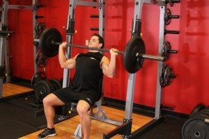 Doing shoulder presses is a great way to give your upper body a workout.
