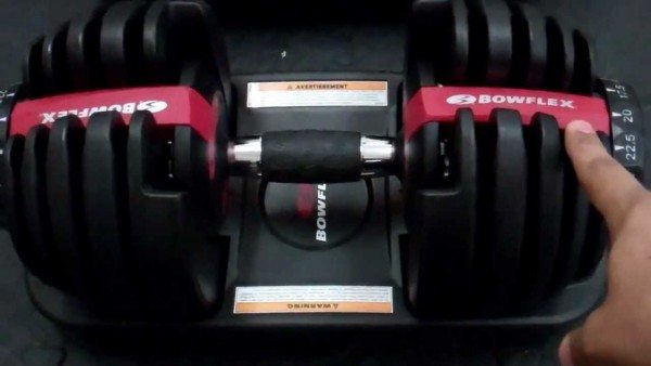 Home workout with adjustable dumbbells